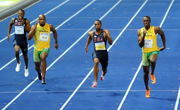 Usain Bolt (R) Tyson Gay (C) and Asafa Powell in the 100m in Berlin