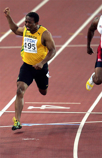 Jamaican sprinter Michael Frater finishes second in the men 100m finals at the 10th IAAF World Athletics Championships in Helsinki, Finland on August 7, 2005 (Photo by Mark Lee/Allsports)